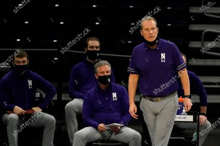 Northwestern head coach Chris Collins, right, watches his team during the second half of an NCAA college basketball game against Nebraska in Evanston, Ill., . Northwestern won 79-78