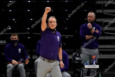 Stock Picture of Northwestern head coach Chris Collins calls his team during the second half of an NCAA college basketball game against Nebraska in Evanston, Ill., . Northwestern won 79-78