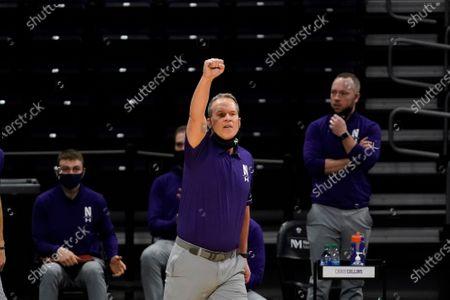 Northwestern head coach Chris Collins calls his team during the second half of an NCAA college basketball game against Nebraska in Evanston, Ill., . Northwestern won 79-78