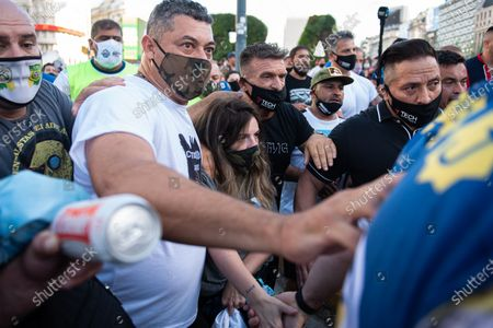 "Dalma Maradona, daughter of Diego Maradona, seen during the demonstration. Demonstrating in downtown Buenos Aires Diego Maradona's fans and family members claimed the legendary Argentinian football player was killed. ""He did not die. They killed him,"" chanted protesters."