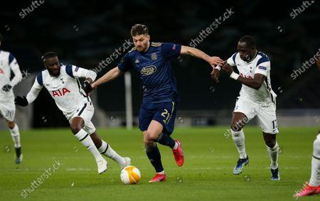 Bruno Petkovic of Dinamo Zagreb takes on Tanguy Ndombele of Tottenham Hotspur & Moussa Sissoko of Tottenham Hotspur