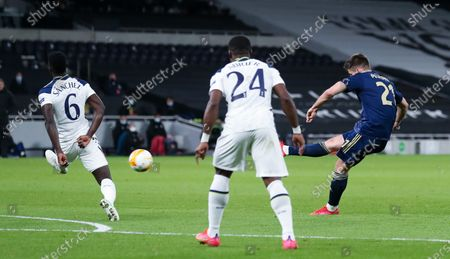 Bruno Petkovic of Dinamo Zagreb takes a shot past Davinson Sanchez of Tottenham Hotspur which is saved by Tottenham Hotspur Goalkeeper Hugo Lloris