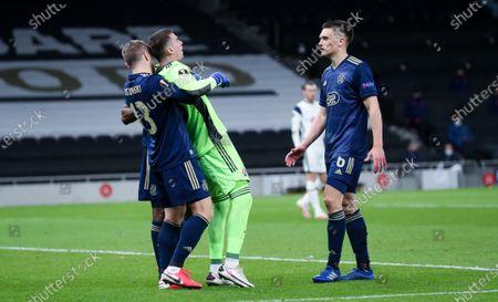 Dominik Livakovic - Dinamo Zagreb Goalkeeper  is winded  helped by his team mates Stefan Ristovski of Dinamo Zagreb & Rasmus Lauritsen of Dinamo Zagreb