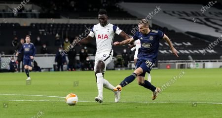 Mislav Orsic of Dinamo Zagreb gets a shot on goal inside the first two minutes - Davinson Sanchez of Tottenham Hotspur (L)