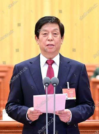 The closing meeting of the fourth session of the 13th National People's Congress (NPC) is held at the Great Hall of the People in Beijing, capital of China, March 11, 2021. Li Zhanshu presided over the closing meeting and delivered a speech.