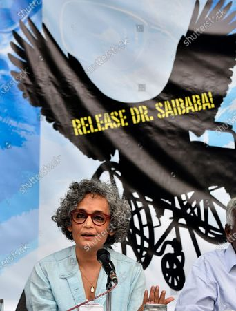 Stock Photo of Author-activist Arundhati Roy addresses a press conference demanding the immediate release of activist Dr GN Saibaba on March 10, 2021 in New Delhi, India.