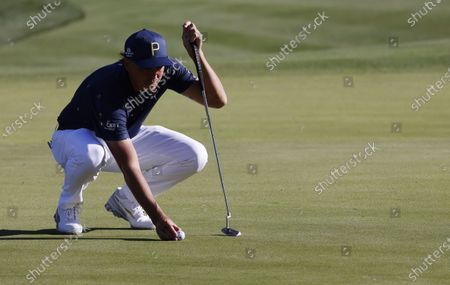 Rickie Fowler of the US lines up his putt on the eleventh hole during the first round of THE PLAYERS Championship golf tournament at TPC Sawgrass, in Ponte Vedra Beach, Florida, USA, 11 March 2021.