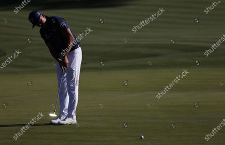 Rickie Fowler of the US putts on the eleventh hole during the first round of THE PLAYERS Championship golf tournament at TPC Sawgrass, in Ponte Vedra Beach, Florida, USA, 11 March 2021.