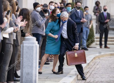 Stock Picture of President Joe Biden's pick for attorney general Merrick Garland, hugs his wife Lynn as he arrives for his first day at the Department of Justice, in Washington. Garland, a one time Supreme Court nominee under President Obama, was confirmed Wednesday by a Senate and will be sworn in later today