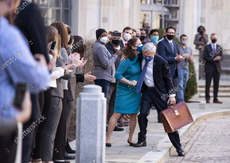 Stock Image of President Joe Biden's pick for attorney general Merrick Garland, hugs his wife Lynn as he arrives for his first day at the Department of Justice, in Washington. Garland, a one time Supreme Court nominee under President Obama, was confirmed Wednesday by a Senate and will be sworn in later today