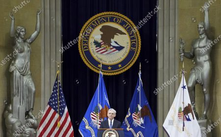 President Joe Biden's pick for attorney general Merrick Garland, addresses staff on his first day at the Department of Justice, in Washington. Garland, a one time Supreme Court nominee under President Obama, was confirmed Wednesday by a Senate and will be sworn in later today