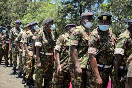 Personnel of the Kenya Defence Forces (KDF) queue up to receive a coronavirus vaccination at the launch of a campaign to vaccinate the country's military and curb the spread of COVID-19, at the Kahawa Garrison near Nairobi, Kenya . As Africa lags in its efforts to vaccinate its 1.3 billion people, the continent must develop the capacity to produce its own COVID-19 vaccines, the director of the Africa Centers for Disease Control and Prevention Dr. John Nkengasong told a press briefing Thursday March 11, 2021
