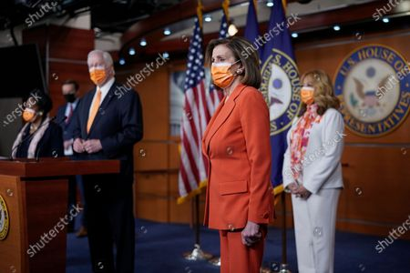 Speaker of the House Nancy Pelosi, D-Calif., holds a news conference on passage of gun violence prevention legislation, at the Capitol in Washington, . She is flanked by Rep. Mike Thompson, D-Calif., chairman of the House Gun Violence Prevention Task Force, left, and Rep. Lucy McBath, D-Ga