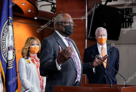 House Majority Whip James Clyburn, D-S.C., flanked by Rep. Lucy McBath, D-Ga., left, and Rep. Mike Thompson, D-Calif., chairman of the House Gun Violence Prevention Task Force, speaks a news conference on passage of gun violence prevention legislation, at the Capitol in Washington