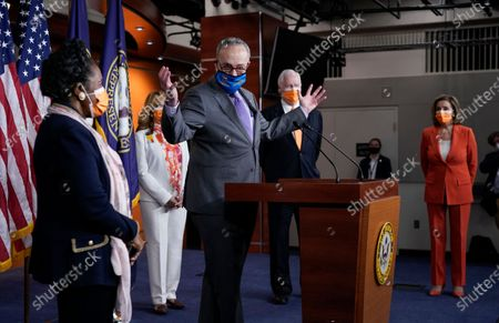 Senate Majority Leader Chuck Schumer, D-N.Y., speaks at a news conference on passage of gun violence prevention legislation, at the Capitol in Washington, . From left are, Rep. Sheila Jackson Lee, D-Tex., Rep. Lucy McBath, D-Ga., Rep. Mike Thompson, D-Calif., chairman of the House Gun Violence Prevention Task Force, and Speaker of the House Nancy Pelosi, D-Calif., holds