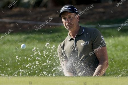Henrik Stenson of Sweden, watches his bunker shot on the ninth hole during the first round of the The Players Championship golf tournament, in Ponte Vedra Beach, Fla