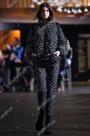 Stock Photo of A model presents a creation by T By Alexander Wang during the Melbourne Fashion Festival (MFF) Gala Runway show at the National Gallery of Victoria, in Melbourne, Australia, 11 March 2021.
