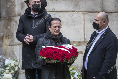 French singer Francis Lalanne (C) carries a wreath of flowers after the funeral ceremony of the late French ballet star Patrick Dupond at Saint Roch church in Paris, France, 11 March 2021. Dupond has died on 05 March 2021 of illness. He was 61.
