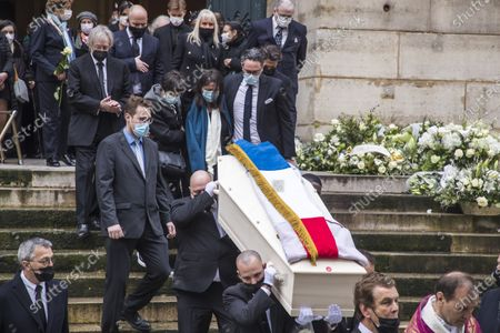 The flag drapped coffin of late French ballet star Patrick Dupond, folowed by his wife Leila Da Rocha (C) and French dancer and choreographer Marie-Claude Pietragalla (C-L) is carried by Pallbearers after a funeral ceremony at Saint Roch church in Paris, France, 11 March 2021. Dupond has died on 05 March 2021 of illness. He was 61.