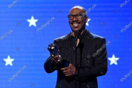Eddie Murphy accepts the lifetime achievement award at the 25th annual Critics' Choice Awards in Santa Monica, Calif. Murphy will be inducted into the NAACP Image Awards Hall of Fame this month. The NAACP announced, that Murphy will be inducted during the March 27 ceremony, which will air on CBS