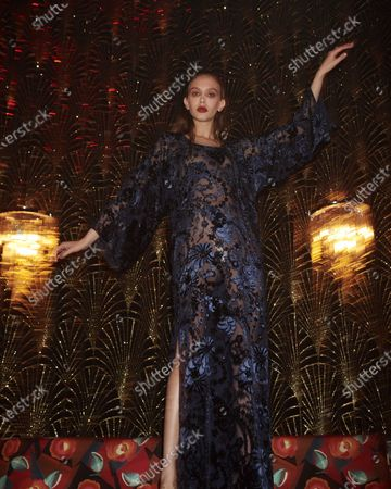 A Model wearing an outfit from the Womens Ready to wear, pret a porter, collections, winter  2021, original creation, during the Womenswear Fashion Week in Paris, from the house of Alexis Mabille