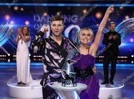 Sonny Jay and Angela Egan celebrate being crowned Dancing on Ice champions 2021, watched by Jayne Torvill and Christopher Dean