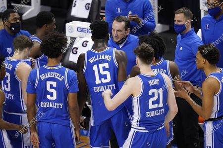 Stock Photo of Duke head coach Mike Krzyzewski, top, talks to his team during the first half of an NCAA college basketball game against Louisville in the second round of the Atlantic Coast Conference tournament in Greensboro, N.C., . Duke has pulled out of the Atlantic Coast Conference Tournament and ended its season after a positive coronavirus test and the resulting quarantining and contact tracing. The ACC announced that the Blue Devils' quarterfinal game with Florida State scheduled for Thursday night has been canceled