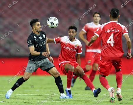 Al-Wehda's player Mohammed Al Qarni (2-L) in action against Al-Hilal's Salem Al-Dawsari (L) during the Saudi Professional League soccer match between Al-Wehda and Al-Hilal at King Abdulaziz Stadium, in Mecca, Saudi Arabia, 11 March 2021.