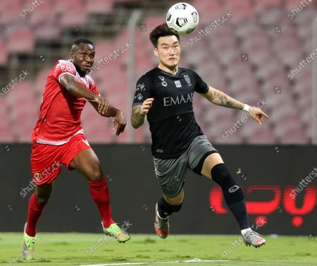 Stock Picture of Al-Wehda's player Youssouf Niakate (L) in action against Al-Hilal's Hyun Soo Jang (R) during the Saudi Professional League soccer match between Al-Wehda and Al-Hilal at King Abdulaziz Stadium, in Mecca, Saudi Arabia, 11 March 2021.