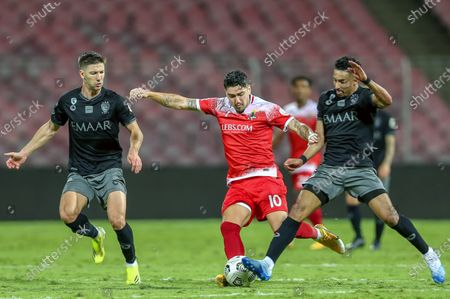 Stock Image of Al-Wehda's player Dimitri Petratos (C) in action against Al-Hilal's Luciano Vietto (L) and Salem Al-Dawsari (R) during the Saudi Professional League soccer match between Al-Wehda and Al-Hilal at King Abdulaziz Stadium, in Mecca, Saudi Arabia, 11 March 2021.