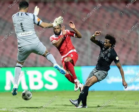 Stock Picture of Al-Wehda's player Hernani Fortes (C) in action against Al-Hilal's Yasir Al-Shahrani (R) and Al-Hilal's goalkeeper Abdullah Al-Mayouf (L) during the Saudi Professional League soccer match between Al-Wehda and Al-Hilal at King Abdulaziz Stadium, in Mecca, Saudi Arabia, 11 March 2021.