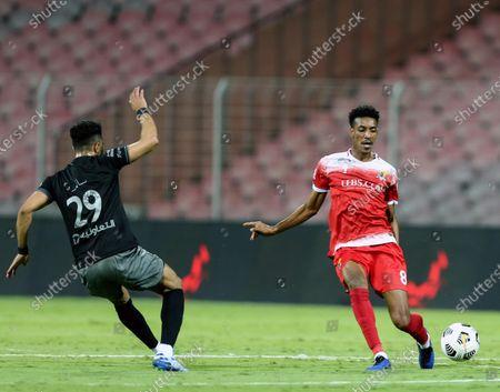 Stock Picture of Al-Wehda's player Mohammed Al Qarni (R) in action against Al-Hilal's Salem Al-Dawsari (L) during the Saudi Professional League soccer match between Al-Wehda and Al-Hilal at King Abdulaziz Stadium, in Mecca, Saudi Arabia, 11 March 2021.