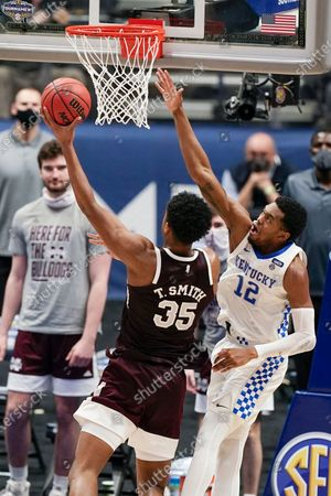 Mississippi State's Tolu Smith (35) shoots against Kentucky's Keion Brooks Jr. (12) in the second half of an NCAA college basketball game in the Southeastern Conference Tournament, in Nashville, Tenn