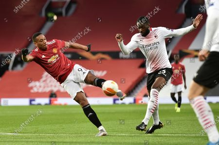 Anthony Martial (L) of Manchester United in action against Fikayo Tomori (R) of Milan during the UEFA Europa League round of 16, first leg soccer match between Manchester United and AC Milan in Manchester, Britain, 11 March 2021.