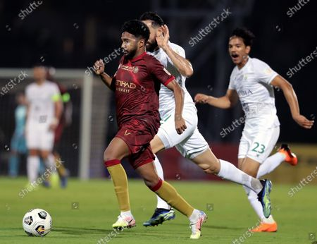 Stock Image of Al-Ahli's player Driss Fettouhi (back) in action against Al-Nassr's Khalid Al-Ghannam (front) during the Saudi Professional League soccer match between Al-Ahli and Al-Nassr at King Abdullah Sport City Stadium, 30 kilometers north of Jeddah, Saudi Arabia, 11 March 2021.