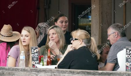 Restaurant patrons sit a for meal at the Fort Worth Stockyards, in Fort Worth, Texas. Gov. Greg Abbott allowed the state mandates for COVID-19 safety measures to expire so the public can forgo masks in public
