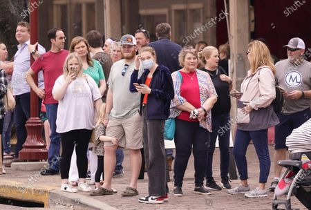 Spectators wait to watch a cattle drive demonstration at the Fort Worth Stockyards, in Fort Worth, Texas. Greg Abbott allowed the state mandates for COVID-19 safety measures to expire so the public can forgo masks in public