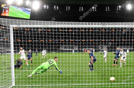 Tottenham's Harry Kane (L) scores the 2-0 past Dinamo goalkeeper Dominik Livakovic (R) during the UEFA Europa League round of 16, first leg soccer match between Tottenham Hotspur and Dinamo Zagreb in London, Britain, 11 March 2021.