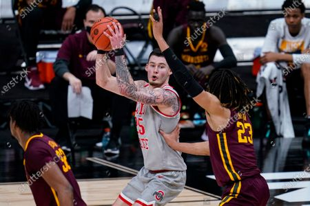 Ohio State forward Kyle Young (25) looks to shoot over Minnesota forward Brandon Johnson (23) in the first half of an NCAA college basketball game at the Big Ten Conference tournament in Indianapolis