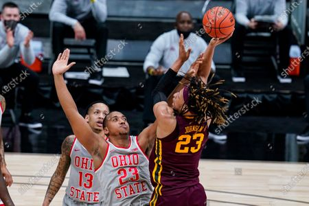 Minnesota forward Brandon Johnson (23) shoots over Ohio State forward Zed Key (23) in the first half of an NCAA college basketball game at the Big Ten Conference tournament in Indianapolis