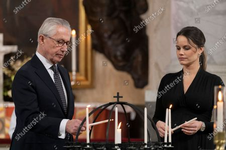 Tord Magnuson and Princess Sofia light candles during a Memorial service at Drottningholm Palace. Due to the anniversary of the first reported covid-19-related death in Sweden, a service was held on Thursday in Drottningholm's castle church., The service was initiated by His Majesty, who in this way wanted to honor the memory of the victims of the pandemic.
