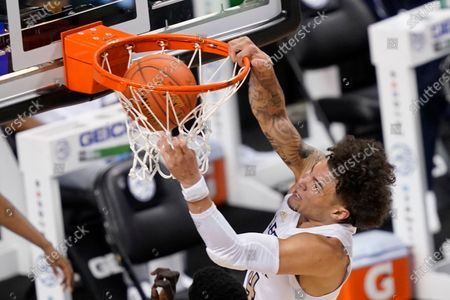 Georgia Tech guard Jordan Usher (4) slams home a dunk during the second half of an NCAA college basketball game against Miami in the quarterfinal round of the Atlantic Coast Conference tournament in Greensboro, N.C