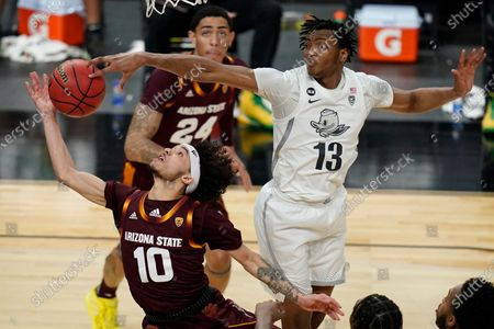 Stock Image of Oregon's Chandler Lawson (13) blocks a shot by Arizona State's Jaelen House (10) during the first half of an NCAA college basketball game in the quarterfinal round of the Pac-12 men's tournament, in Las Vegas