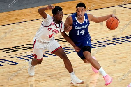 Stock Picture of Seton Hall guard Jared Rhoden (14) drives against St. John's guard Greg Williams Jr. (4) during the first half of an NCAA college basketball game in the quarterfinals of the Big East conference tournament, in New York