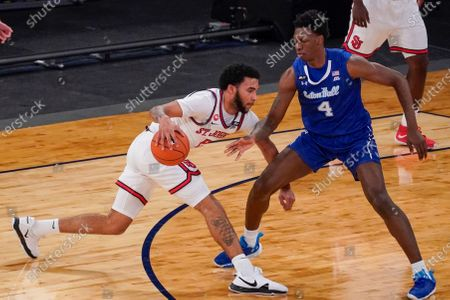 Stock Picture of St. John's guard Julian Champagnie, left, drives against Seton Hall forward Tyrese Samuel (4) during the first half of an NCAA college basketball game in the quarterfinals of the Big East conference tournament, in New York