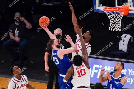 Seton Hall forward Sandro Mamukelashvili (23) goes to the basket against St. John's guard Greg Williams Jr. (4) and forward Marcellus Earlington (10) during the second half of an NCAA college basketball game in the quarterfinals of the Big East conference tournament, in New York