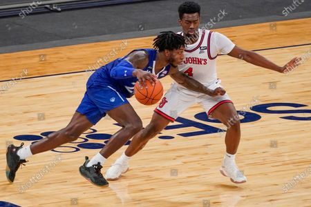 Seton Hall guard Myles Cale drives against St. John's guard Greg Williams Jr. (4) during the second half of an NCAA college basketball game in the quarterfinals of the Big East conference tournament, in New York