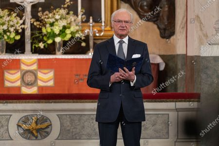 King Carl Gustaf reads a text during a Memorial service at Drottningholm Palace Church March 11, 2021. Due to the anniversary of the first reported covid-19-related death in Sweden, a service was held on Thursday in Drottningholm's castle church., The service was initiated by His Majesty, who in this way wanted to honor the memory of the victims of the pandemic.,