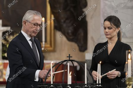 Stock Image of Tord Magnuson and Princess Sofia light candles during a Memorial service at Drottningholm Palace Church March 11, 2021. Due to the anniversary of the first reported covid-19-related death in Sweden, a service was held on Thursday in Drottningholm's castle church., The service was initiated by His Majesty, who in this way wanted to honor the memory of the victims of the pandemic.,