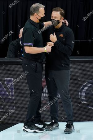 Stock Image of Northwestern head coach Chris Collins talks with Minnesota head coach Richard Pitino before an NCAA college basketball game at the Big Ten Conference tournament, in Indianapolis